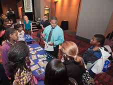 Students surrounded the NASA booths at Education Day to learn how astronauts live and work in space