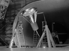 A Langley technician checks the Mercury full-scale capsule model in 1959.