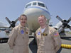Pilots Mike Singer, left, and Shane Dover stand in front of the 117-foot P-3B NASA research aircraft on the tarmac at Baltimore/Washington International Thurgood Marshall Airport, Tuesday, June 28, 2011, in Baltimore, Md.
