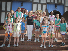 Lesa Roe with Girl Scouts.