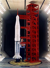 A model of the Saturn V and launch tower in a Langley wind tunnel