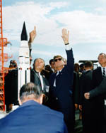 President John F. Kennedy and Dr. Werner von Braun inspect a Saturn launch vehicle
