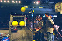 Load em up! The round begins with the New Horizons human player loading one basket full of balls.