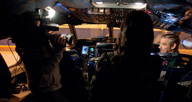 Members of the media interview a member of the flight crew of NASA's P-3B environmental science aircraft about the DISCOVER-AQ air quality survey mission over California's San Joaquin Valley during the Airborne Science media day at NASA's Dryden Aircraft Operations Facility in Palmdale, Calif.