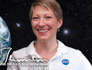 mugshot of smiling woman with earth/space background