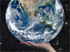 artist concept of a hand holding Earth