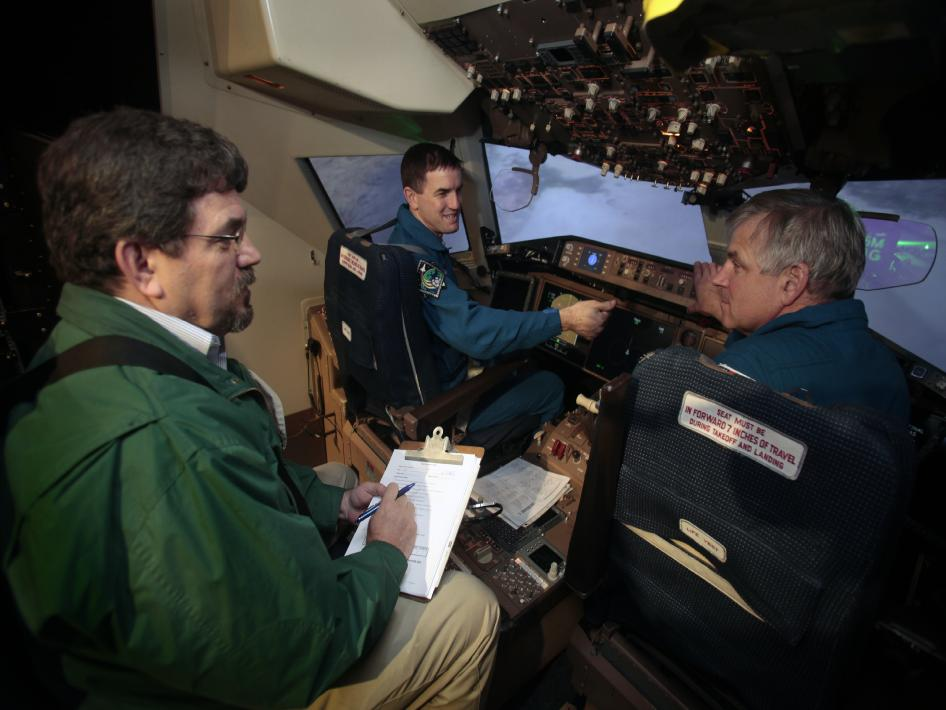 Astronauts in simulator.