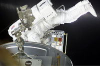 During a space walk, astronaut Patrick G. Forrester installs the MISSE experiment, which will expose Researchers examine colorful coatings destined for the International Space Station as part of the MISSE experiment