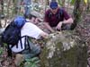 Deep in the Guatemalan jungle, Sever, right, and Griffin study a crumbled stele.