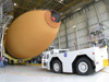 Space shuttle external tank ET-119 rolls out at NASA's Michoud Assembly Facility.