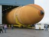 External tank 119 rolls out of the final assembly building at NASA's Michoud Assembly Facility in New Orleans on its way to the Kennedy Space Center.