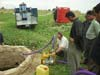 Volunteers in the Iraqi village of Kendala help install and test a water purification system with NASA technology.