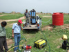 Volunteer aid workers in the northern Iraq village of Kendala assemble and test a new water purification system.