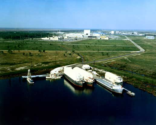 An aerial view of the NASA dock at Michoud Assembly Facility with four barges