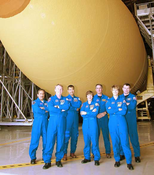 The STS-114 crew is shown with ET-120.