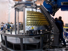 Technicians at NASA's Michoud Assembly Facility in New Orleans prepare the Universal Weld System II to begin the first friction stir weld on the Orion crew module ground test article.