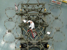 Pictured with the Optical Telescope Element (OTE) of the James Webb Space Telescope, mockup is Josh Levi, the OTE Integration and Test lead.
