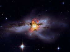 Composite Chandra and Hubble image of galaxy NGC 6240.