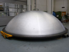 "The second single-piece 5.5 meter diameter full-scale spun form dome was manufactured from a flat plate ""blank"" made from two pieces of aluminum lithium 2195 plate which were friction stir welded together."