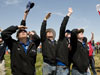 A wowed crowd watches another rocket hurtle skyward during the annual NASA Student Launch Projects rocketry challenge.