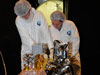 NASA engineers inspect the Fast, Affordable, Science and Technology Satellite, or FASTSAT, after successfully completing a comprehensive pre-shipment review.