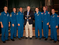 The crew of STS-132 flanks Mark Bryant, vice president of Lockheed Martin's ET Program.