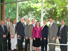 From left to right: State Rep. Greg Cromer, Dusty Irwin of Babcock & Wilcox, Doug Mouton of Jacobs, Malcolm Wood of NASA, Mike Dawson of Jacobs, Steve Doering of NASA, Councilwoman Jackie Clarkson, Bobby Savoie of Geocent, John Filostrat of Jacobs and Bob Fudickar of LED.