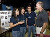 From left, siblings Janet Nieto, Ana Karen Nieto and Hilario Nieto discuss their flight vehicle with Steve Cash, manager of the Shuttle Propulsion Office at the Marshall Center.