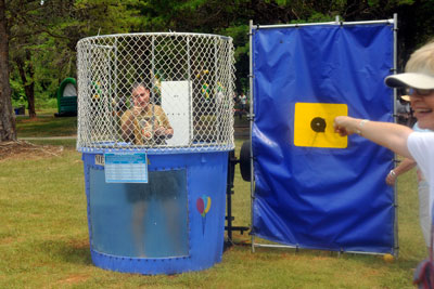 Center Director Robert Lightfoot gives a thumbs up after cooling off following his first dunk in the dunking booth.