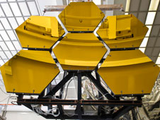 Engineers and technicians guide six James Webb Space Telescope's mirror segments off the rails after completing final cryogenic testing this week at Marshall.