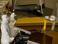 Engineers ready the crane to lift one James Webb Space Telescope's mirror segment off the stand after completing final cryogenic testing this week at Marshall.