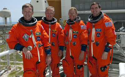 Space Shuttle Atlantis' crew members, from left, Commander Chris Ferguson, Pilot Doug Hurley and Mission Specialists Sandy Magnus and Rex Walheim