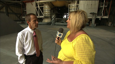 Space Shuttle Reusable Solid Rocket Booster Manager David Beaman, left, is interviewed by