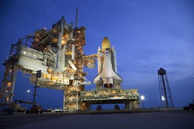 Space shuttle Atlantis, on the launch pad at NASA's Kennedy Space Center.