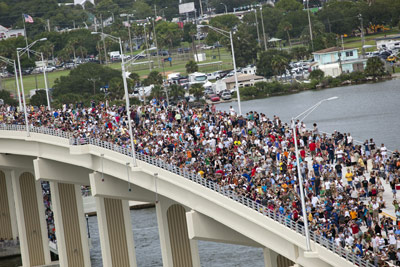 Residents and visitors to Florida's Space Coast crowd the new A. Max Brewer Bridge in Titusville to see space shuttle Atlantis soar into space for the last time.