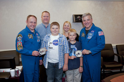 The Plunkett family meet astronauts Gregory Johnson and Michael Fincke.
