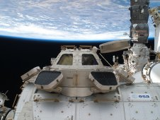 The Cupola of the International Space Station, backdropped against Earth.