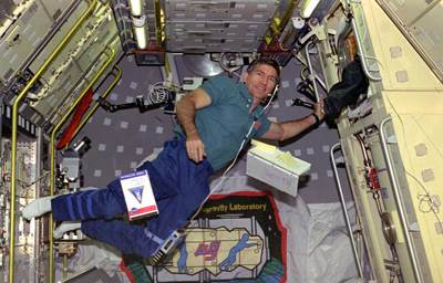 Leslie conducts research in shuttle Columbia's cargo bay during the STS-73 mission in 1995.