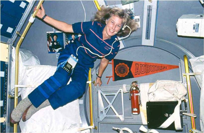 Davis, inside the Spacelab module near her Auburn pennant, during her first trip to space on the STS-47 mission in 1992.