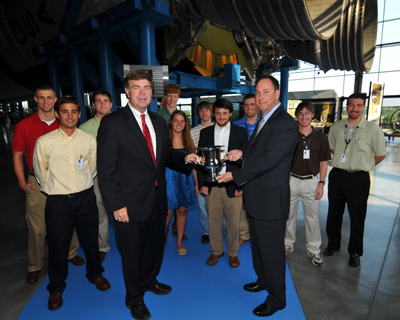 At the Aug. 2 Marshall Center Director's Breakfast at the U.S. Space & Rocker Center, Mayor Tommy Battle, front left, presented the Intern Cup to Marshall Space Flight Center Director Robert Lightfoot, front right, while Marshall summer interns look on.