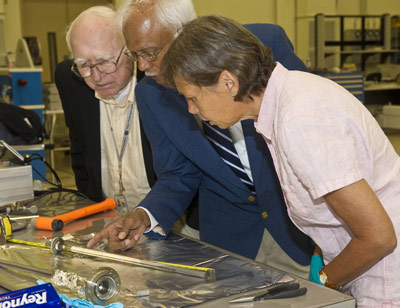 German researcher Dr. Petra Neuhause, right, examines the sample, joined by Dr. Alex Lehoczky, left, materials scientist at the Marshall Center, and Dr. Surendra Tewari, center, professor at Cleveland State University in Ohio, where the sample was sent for additional study.