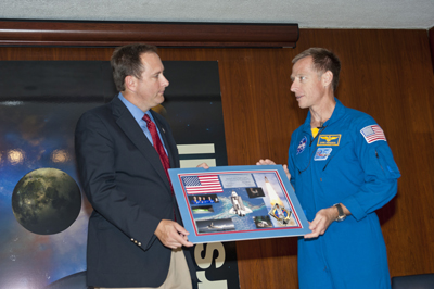 Commander Chris Ferguson, right, presents a pictorial montage of the STS-135 mission to Marshall Center Director Robert Lightfoot.