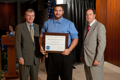 Dr. Matthew Adler, center, receives his Marshall Software of the Year Award at the July 28 Marshall Center Honor Awards ceremony. He is flanked by Bryan O'Connor, left, NASA chief, Safety & Mission Assurance, and Marshall Center Director Robert Lightfoot.