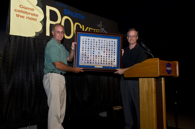Marshall Shuttle Propulsion Office Manager Steve Cash, left, presents a mission pin plaque to John Shannon, manager of the Space Shuttle Program.