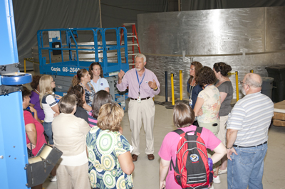 Tim Vaughn, materials engineer supervisor in the Materials & Processes Laboratory, center, gives the teachers a tour of the friction stir-welding center in Building 4755.