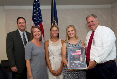 Marshall Space Flight Center Director Robert Lightfoot, left, awards Anna Morgan Crumbley, second from right, with a prestigious 2011 NASA College Scholarship. Joining her is her mother Ashlyn, second from left, sister Mae, center, and father Tim, right.