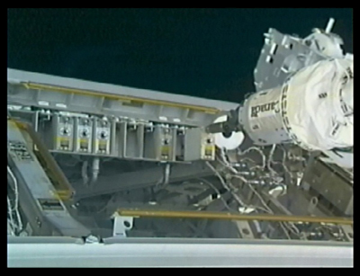 Dextre's hand slides the faulty circuit-breaker box out of its casing.