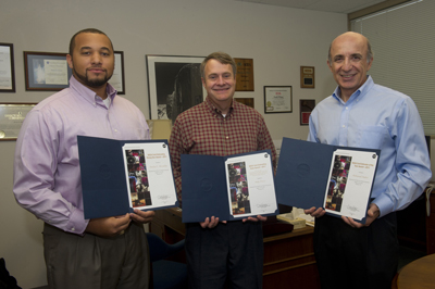 Marshall Center cost engineers, from left, Stanley McCaulley, Andy Prince and Mahmoud Naderi received honors at the annual NASA Cost Analysis Symposium in Houston Aug. 15-18. Not pictured is Scott May.