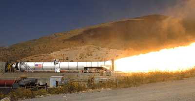 NASA and ATK's five-segment solid rocket motor fires during the Development Motor-3 test in Promontory, Utah, Sept. 8.