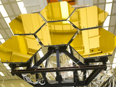 Engineers and technicians from NASA's Marshall Space Flight Center in Huntsville, Ala. and Ball Aerospace in Boulder, Colo., remove mirrors from the vacuum chamber after completing final cryogenic testing on six of the 18 mirror segments that will form NASA's James Webb Space Telescope�s primary mirror.